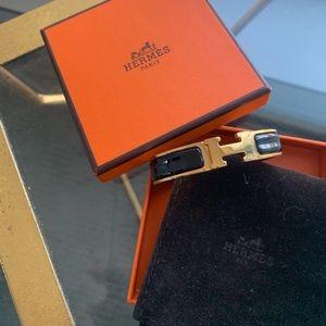Authentic! Hermès clic h PM in black and gold